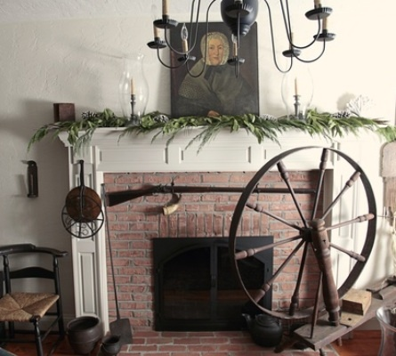 White fireplace with brick showing