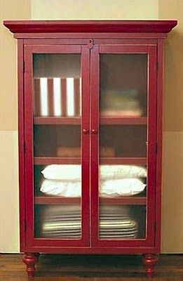 linen storage for hall - what about something like this? a refurbished china cabinet basically. frost out the glass panes so you can't see in but it still feels more open