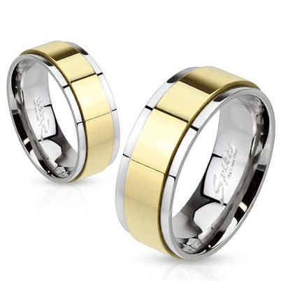 Beautiful two-tone stainless steel ring in mirror polish finish with 14K gold ion plated spinning band. Instant Classic.  ◦Beautifully crafted couple ring in Stainless Steel. ◦Great for casual wear or even special occasions. ◦Comfort Fit - Slightly ...
