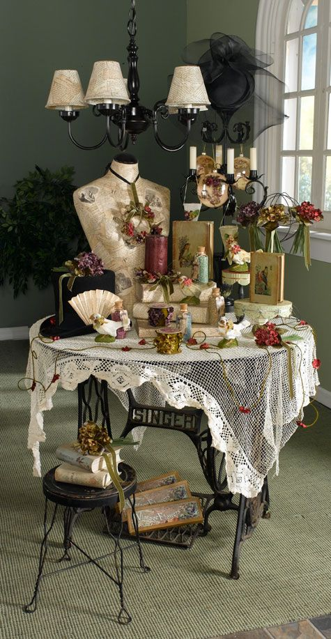 love the display,and the old sewing machine table!!!