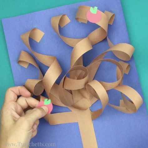 This constructions paper tree is a fun 3d construction paper craft. Create it all seasons by just switching up the apples for blossoms, green leafs, fall leaves, or leave them bare.