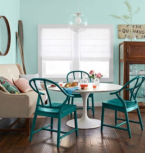 Beach bungalow with white tulip dining table and blue painted chairs... and  nautical