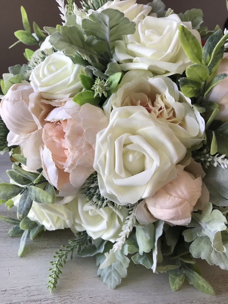 Rustic bridal bouquet with roses and Peonies
