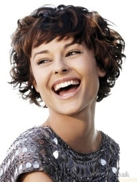 Short curly hair with straightened bang. I like it but could I get away with it? I think no.