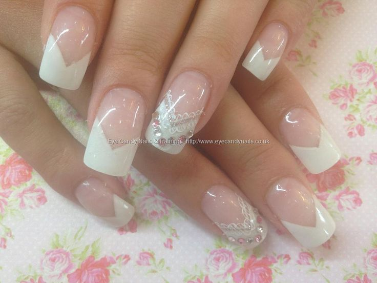 White gel chevron tips with hand painted lace nail art and Swarovski crystals