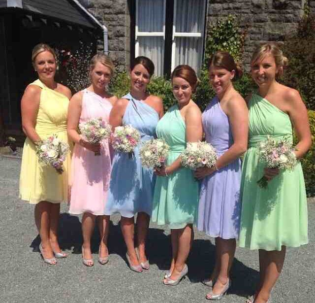 Amazing day....These colours looked so good together! I'm third from the right. Pastel multicoloured bridesmaid dresses