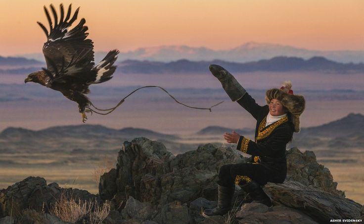 Ashol-Pan on a mountain top with her eagle
