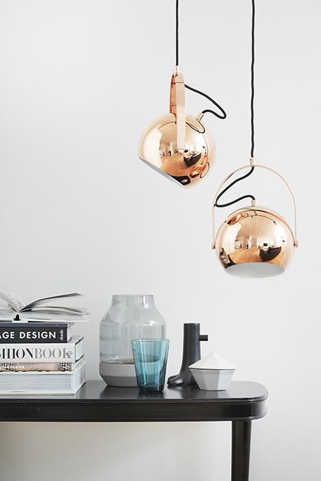 A classic Danish design lamp returns! The Ball designed by Benny Frandsen in 1972 is back as Ball with Handle in copper and brass.