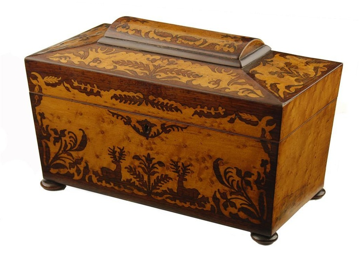 "Victorian rosewood & birds' eye maple marquetry sarcophagus shape tea caddy, front decorated with apair of stags & foliage. It has a central cut glass mixing bowl flanked by a pair of lidded compartments, on flattened bun feet, 7.5""H, 12""W, 6.5""D, Woolley and Wallis - Salisbury Salerooms"