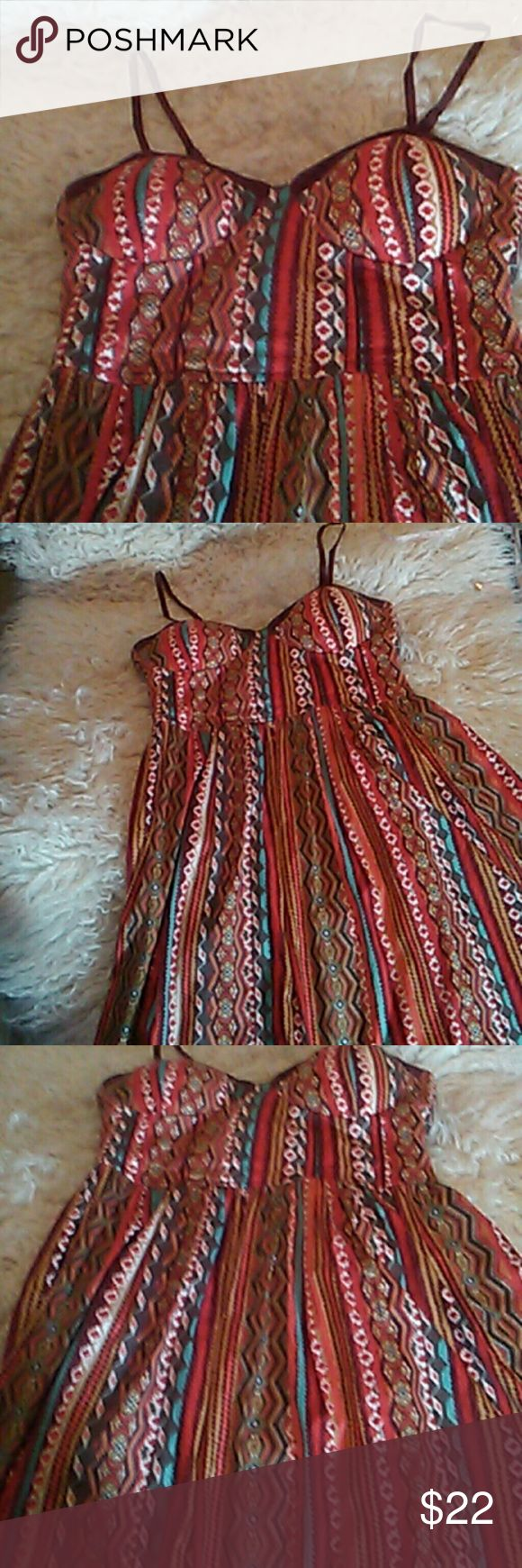 American Rag bustier mini dress Multicolor tribal print bustier size large spaghetti straps adjustable and elastic in the back link from armpit to him line is 25 inches would like you're right with leggings or yellow shorts or your preference of shorts for the summer or Festival season American Rag Dresses Mini