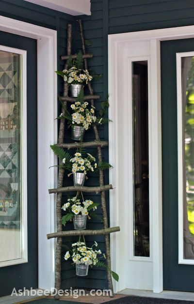 DIY Ladder and hang plants from it...or maybe make ledges wide enough to set some on it...: