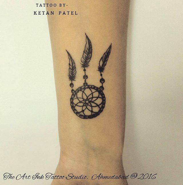 Dreamcatcher tattoo on wrist