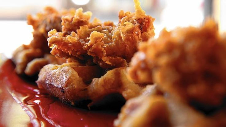 Yeasty Belgian waffles serve as a bed for buttermilk fried boneless chicken thighs at Luella's Southern Kitchen.