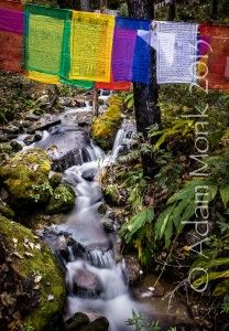 Prayer flags over a small stream.  Photographic tour of Bhutan 2013