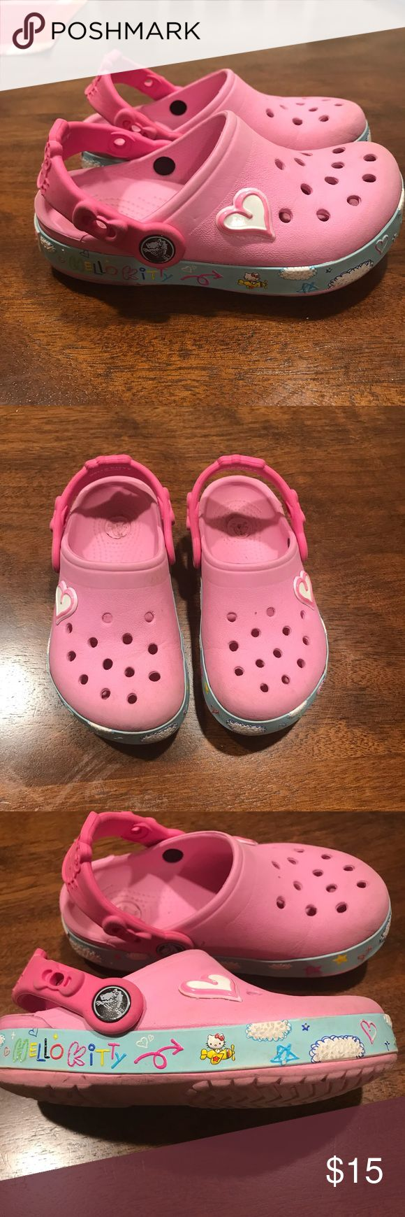 Little girls Hello Kitty Crocs The cutest Hello Kitty Crocs! Great used condition. CROCS Shoes Sandals & Flip Flops