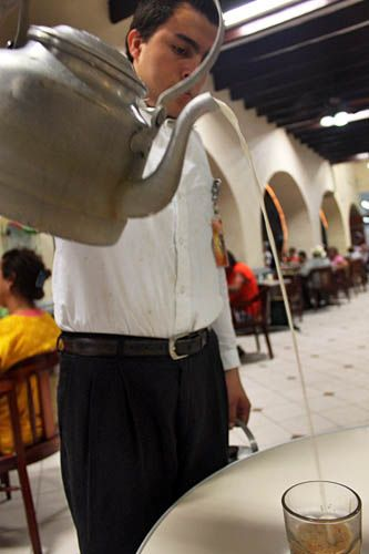 "Pouring a lachero (espresso and steamed milk) at the Gran Cafe del Portal in the Zócalo | From the post ""Lecheros and Danzón at the Zócalo in Veracruz, Mexico"" by Barbara Weibel"