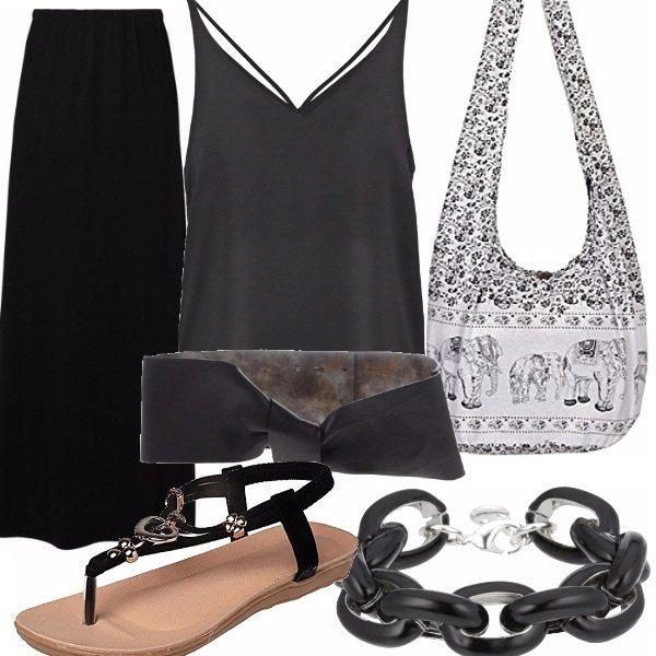 Una gonna vita bassa abbinata ad un top da portare dentro con cintone in vita. Un sandalo nero e come borsa la classica borsa a spalla che, chi ama questo stile, non può non avere di mille colori nel proprio armadio.