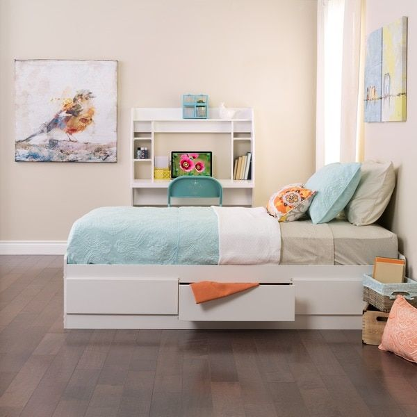 With three spacious drawers and sturdy length-wise wooden slats, this white platform bed provides both spacious storage and comfortable support. Made with wood and medium density fiberboard, the bed p