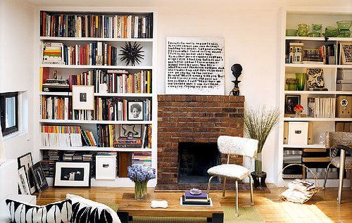 small living room with bookshelves & fireplace