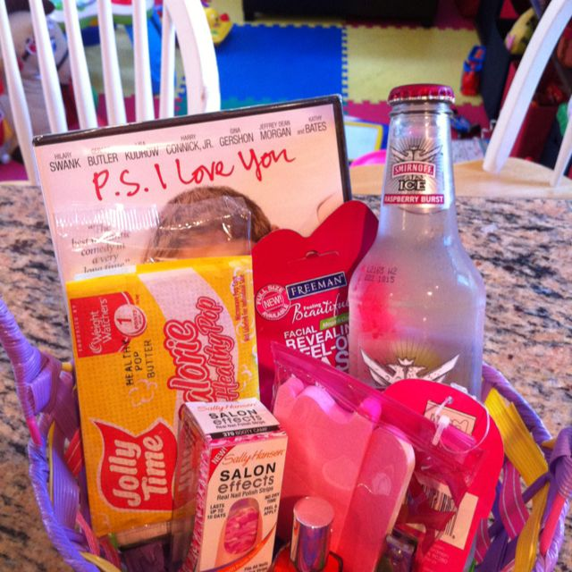 1st night of deployment survival kit for the spouse left at home! Chick flick, Smirnoff, small bag of popcorn, facial mask, pedicure kit, nail polish, and Sally Hansen pink camp nail polish strips! We also made dinner and cupcakes for our friend so she could cry instead of cook :)