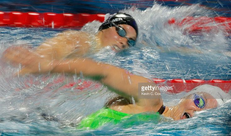 Jazzmin Carlin of Great Britain competes against Hali Flickinger in the Women's 400m Freestyle during day one of the Mutual of Omaha Duel in the Pool at Indiana University Natatorium on December 11, 2015 in Indianapolis, Indiana.