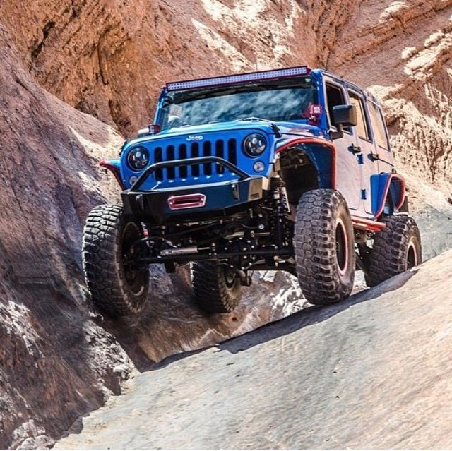 BLU JEEP BOUNCING OFF THE WALL