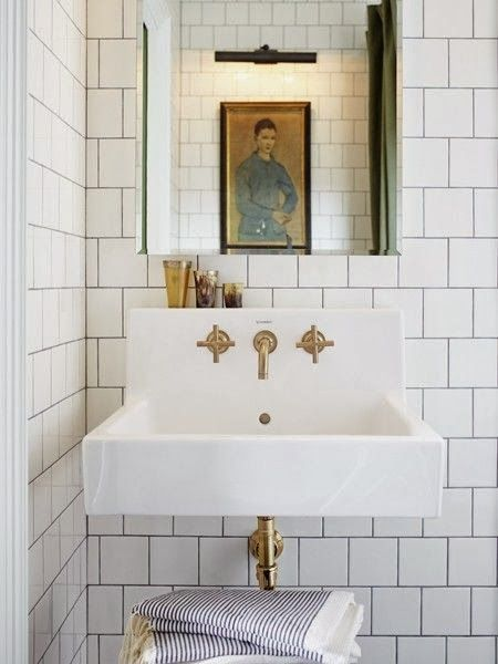 Fixture placement, small size sink, BRASS! Every home should have: White marble bathrooms with brass fixture