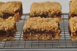 Date Squares are a delicious combination of pureed dates sandwiched between layers of buttery oatmeal crust. From Joyofbaking.com With Demo Video