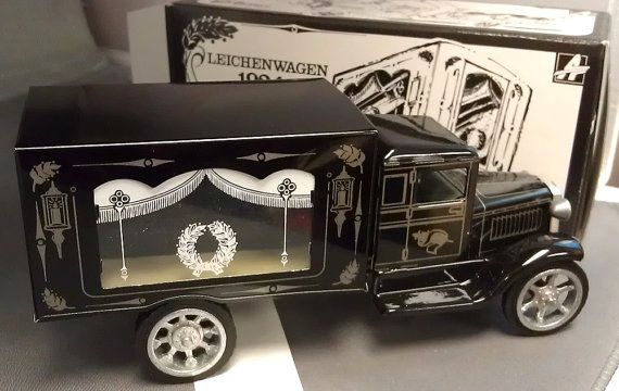 KOVAP Leichenwagen 1924 Hearse Pohrebni Vuz New in Box. Hearse reproduction with coffin in back. Pressed Steel from Czech Republic.