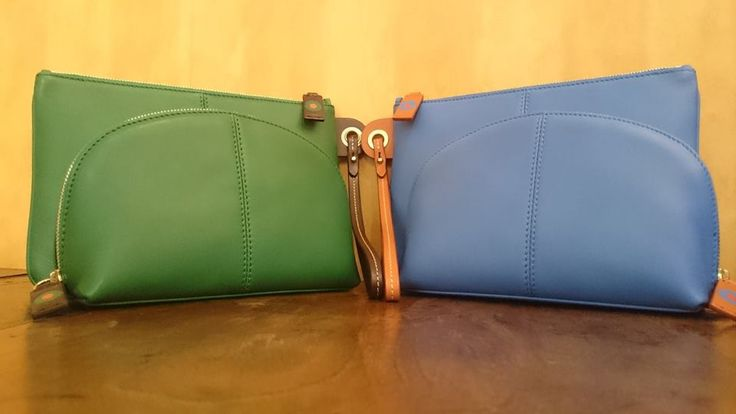 """""""Wristlet bag + Cosmetic pouch....2 essentials in 2 colors"""""""