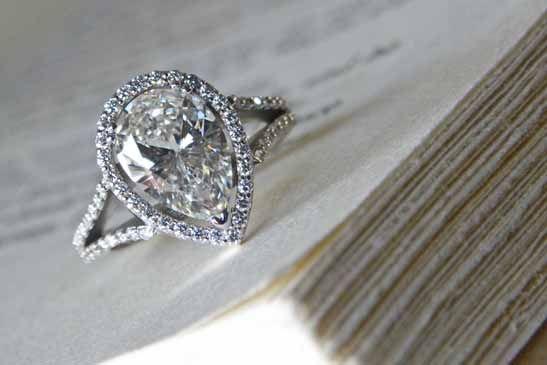 Pear shaped diamond with diamond split shank and diamond halo.  J ALBRECHT DESIGNS