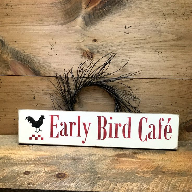 "This sign reads ""Early Bird Cafe'"". It measures approx 5.5""W x 25""L. It has been painted a Craft White, then sanded and distressed for a great OLD look. It would be a wonderful addition to that countr"