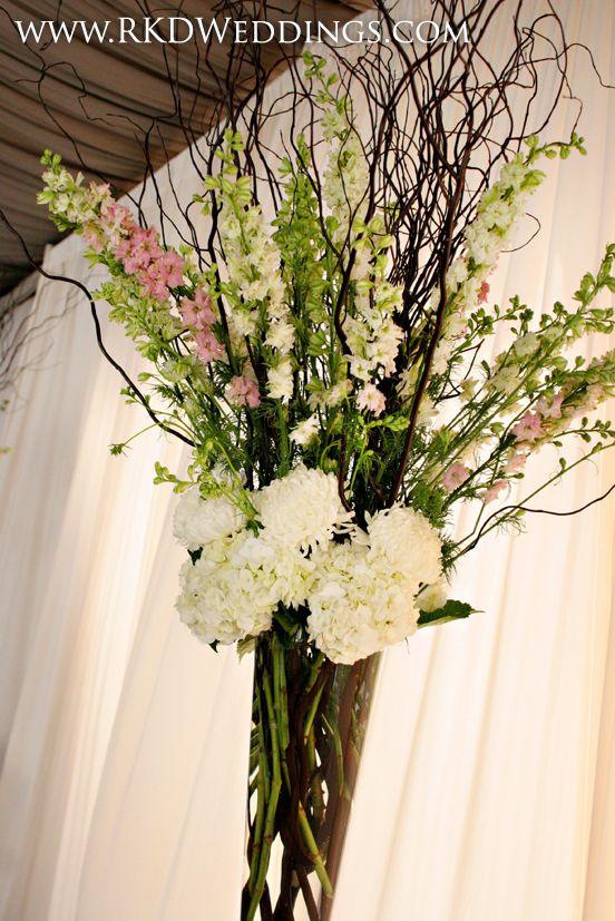 Vased arrangement of curly willow white hydrangea