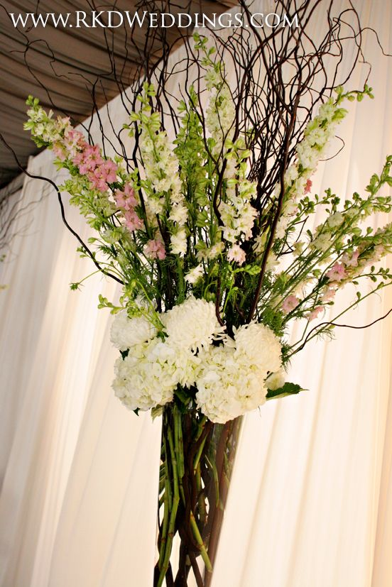 Vased arrangement of curly willow white hydrangea