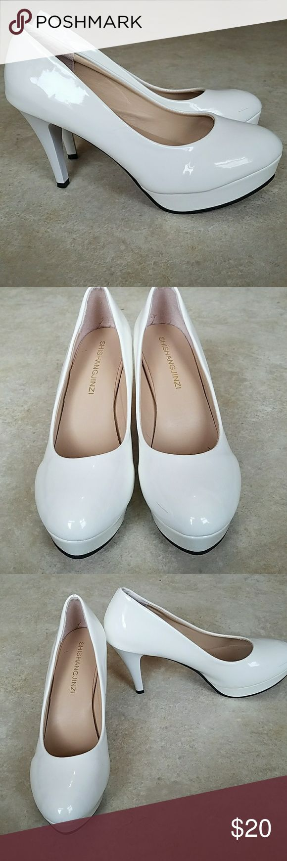 White Platform Pumps White vinyl platform pumps with cute red bottoms. Worn once, but there is some slight wear on the bottom and a scuff on the right toe  Soles say size 42, but fits more like a US size 9 Shoes Heels