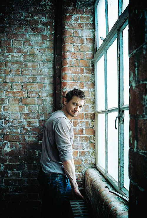 Keep your look unified. This urban rustic style is affected by combining denim Jeremy Renner with an unfinished brick wall.