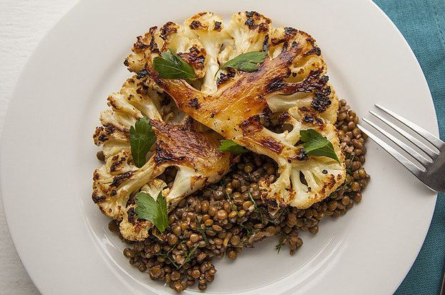 cauliflower steaks: slice cauliflower into thick slices; rub with olive oil, salt and pepper; roast face up for 15, flip, roast for another 15; serve with lentils and sprinkle with parsley.