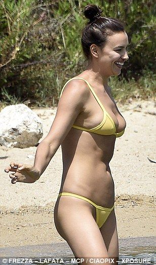 Chirpy: Irina seemed in good spirits as she frolicked on the beach in her swimwear
