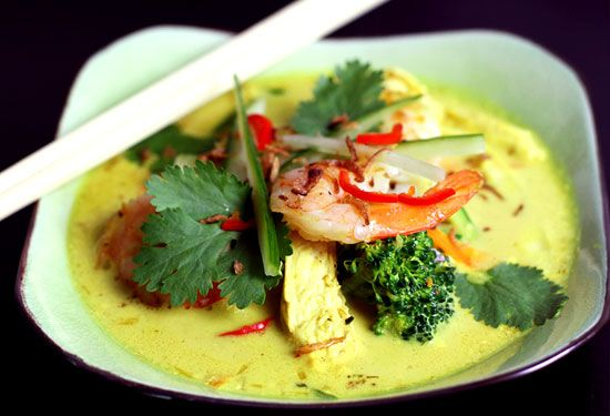 This prawn and chicken Thai laksa soup recipe is made with thinly sliced zucchini instead of noodles. The curry paste is made from scratch and can be used for curries.