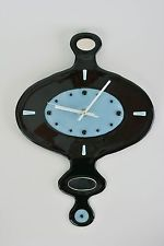 Unusual design glass wall clock with pieces of mirror.