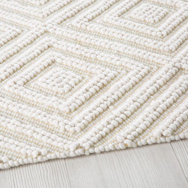 Teppich aus Wolle und Baumwolle, ecrufarben mit grafischen Motiven 140×200
