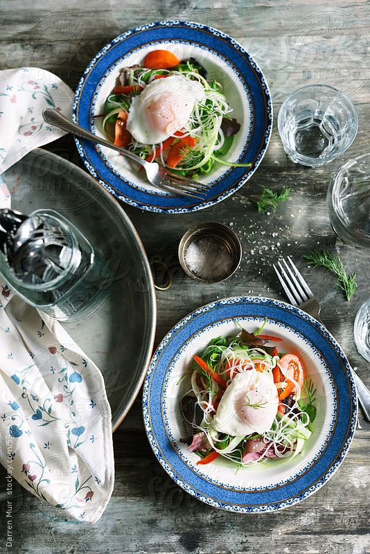 Poached egg and rice noodle salads on table, seen from above. by DarrenMuir | Stocksy United