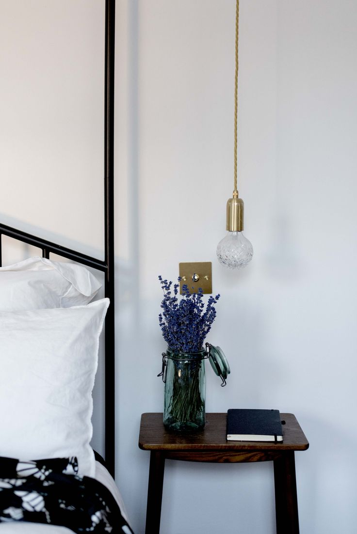 BEDROOM DETAILS - Creative Director Amy Powney's bedroom features pendant lighting above the nightstand. #motherofpearl #pearlyqueen #amypowney #interiors #bedroomideas