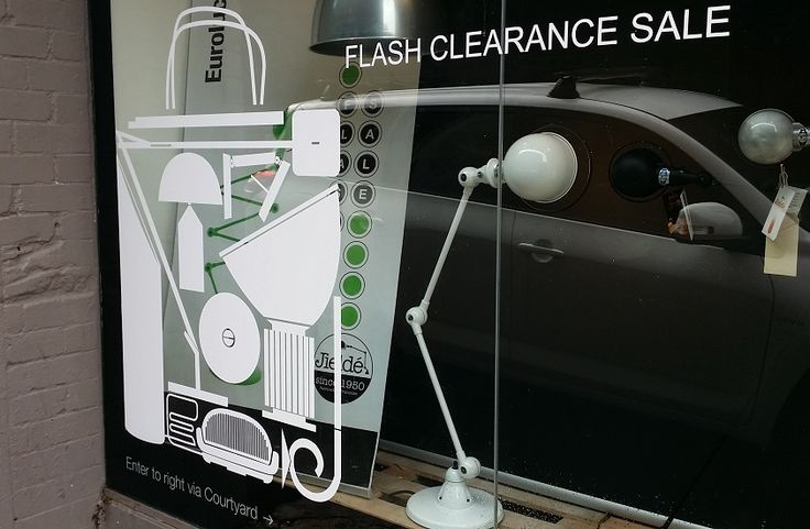 white Sale decals for Euroluce shop window