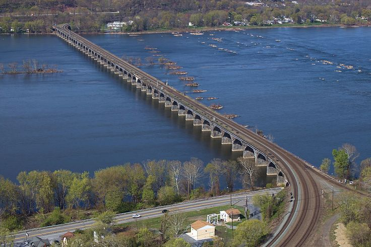 The Rockville Bridge, at the time of its completion in 1902, was, and still remains, the longest stone masonry arch railroad viaduct in the world.[1] Constructed between 1900 - 1902 by the Pennsylvania Railroad, it has forty-eight 70-foot spans, for a total length of 3,820 ft. The bridge crosses the Susquehanna River about 5 miles north of Harrisburg, PA. The eastern end is in Rockville and the western end is just south of Marysville.