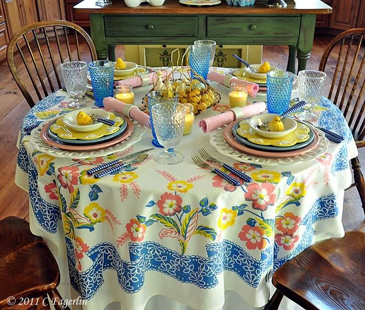 love this --charming use of vintage table linens and glassware.  Mixture of colored plates is perfect.