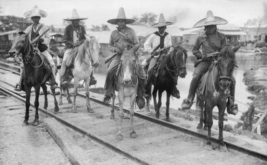 Photograph:Peasant soldiers patrol the town of Tampico during the Mexican Revolution.
