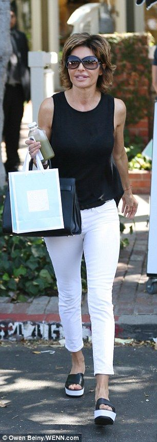 Stocking up on face treats: Lisa Rinna and show newcomer Erika Jayne filmed scenes for Rea...