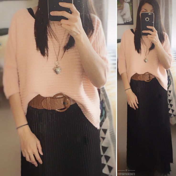 Winter fashion - peach colored knit top paired with belted long black skirt