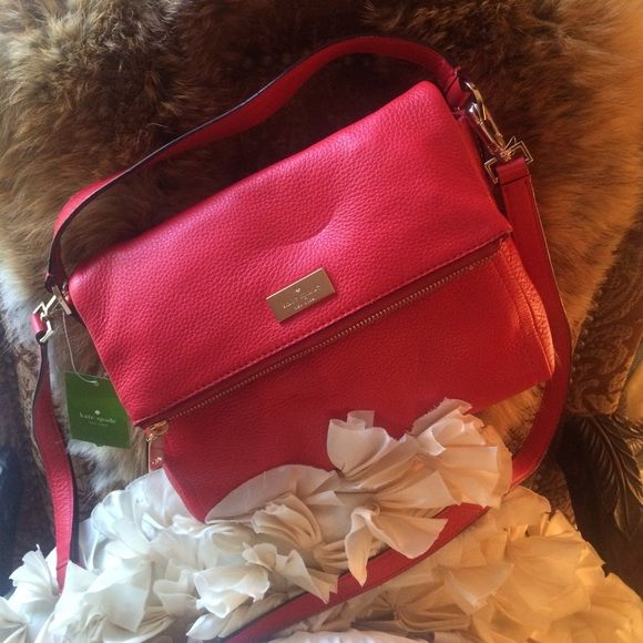 Kate Spade Handbag Chic versatile handbag or cross body bag. Beautiful bright red color, lined in hot pink monogrammed canvas. One interior pocket with magnet and one large exterior pocket with top zip closure. Gold hardware. New with tags and dust bag. kate spade Bags